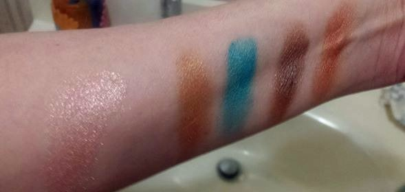 Left to right: Mica Cosmetics Shimmer Powder 72 Earth, Be A Bombshell Cosmetics Bora Bora eyeshadow quad: Copper, Turquoise,  Deep Brown and Bronze